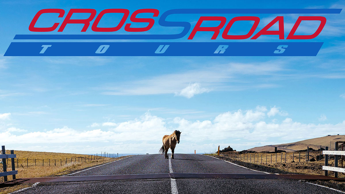 A horse on the open road with the Crossroad Tours logo.