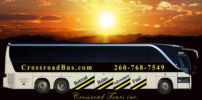 Crosroad Tours tour bus with sunset.
